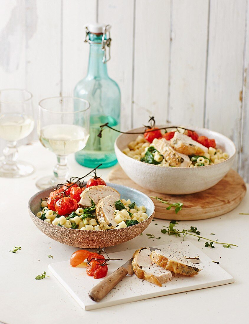 Pasta risotto with leaf spinach, roast tomatoes and chicken fillet