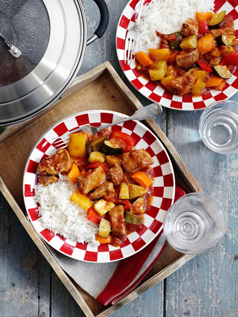 Pork ragout with vegetables served with rice