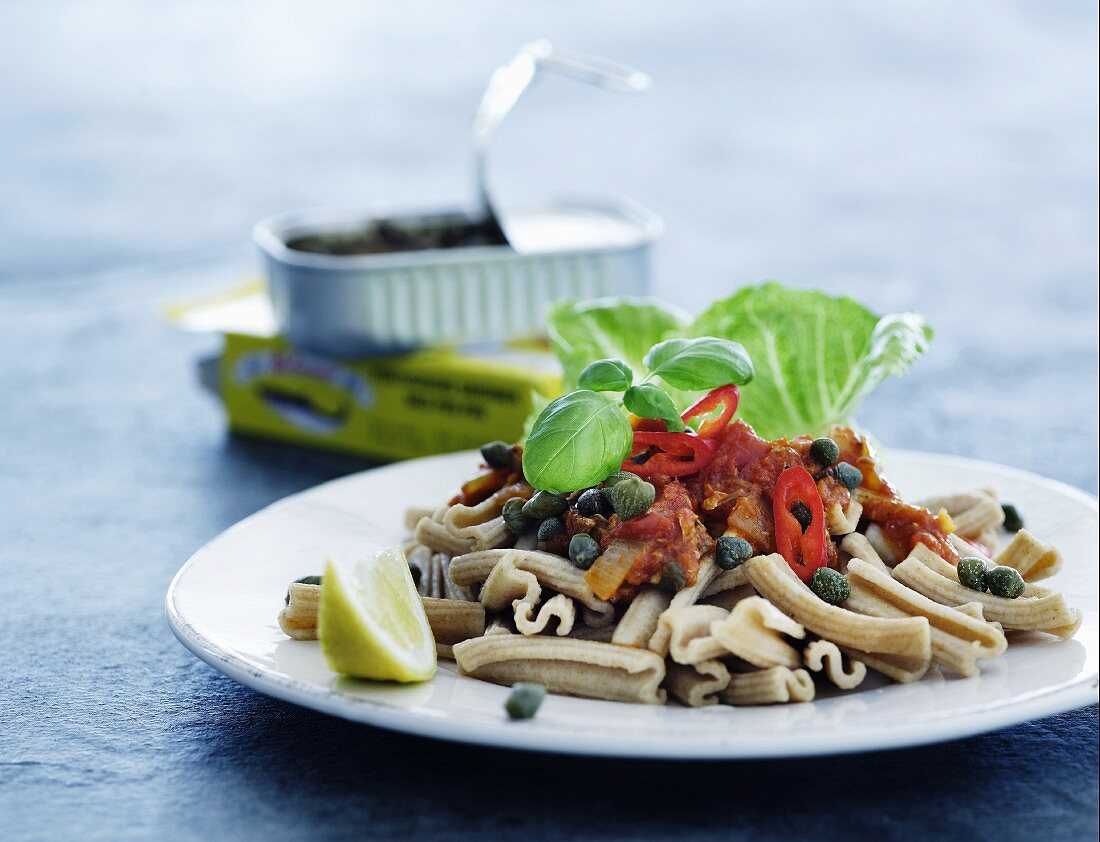 Wholemeal pasta with sardine sauce, capers and chilli rings