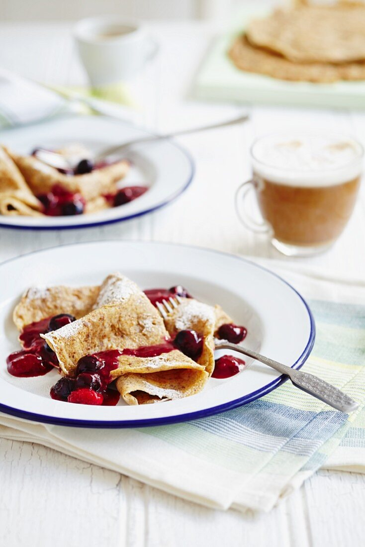 Pancakes with cherries and fruit sauce