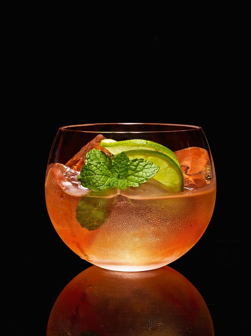A cocktail made with vodka, mint and lime