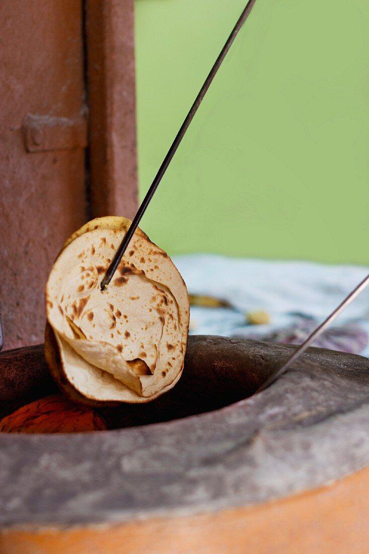 Freshly baked tandoori rotis baked in a tandoori oven (India)