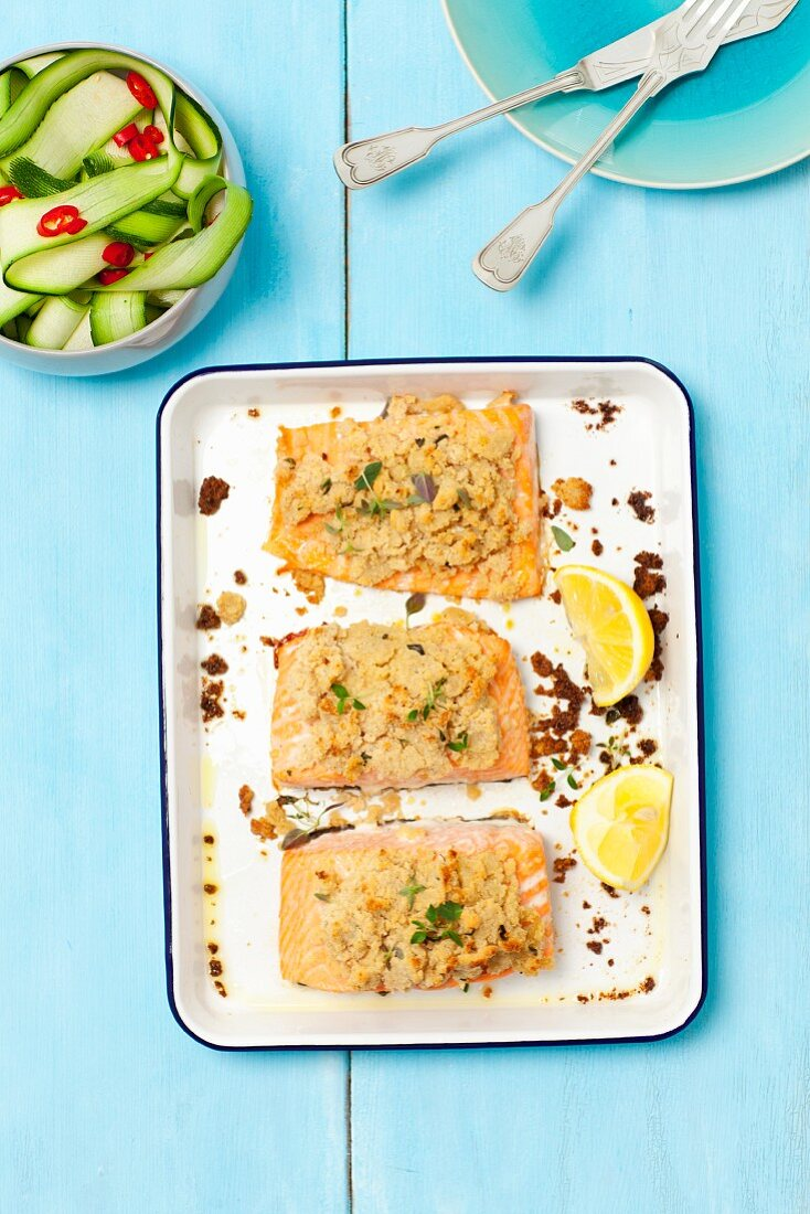 Baked salmon with a horseradish crust and a courgette salad