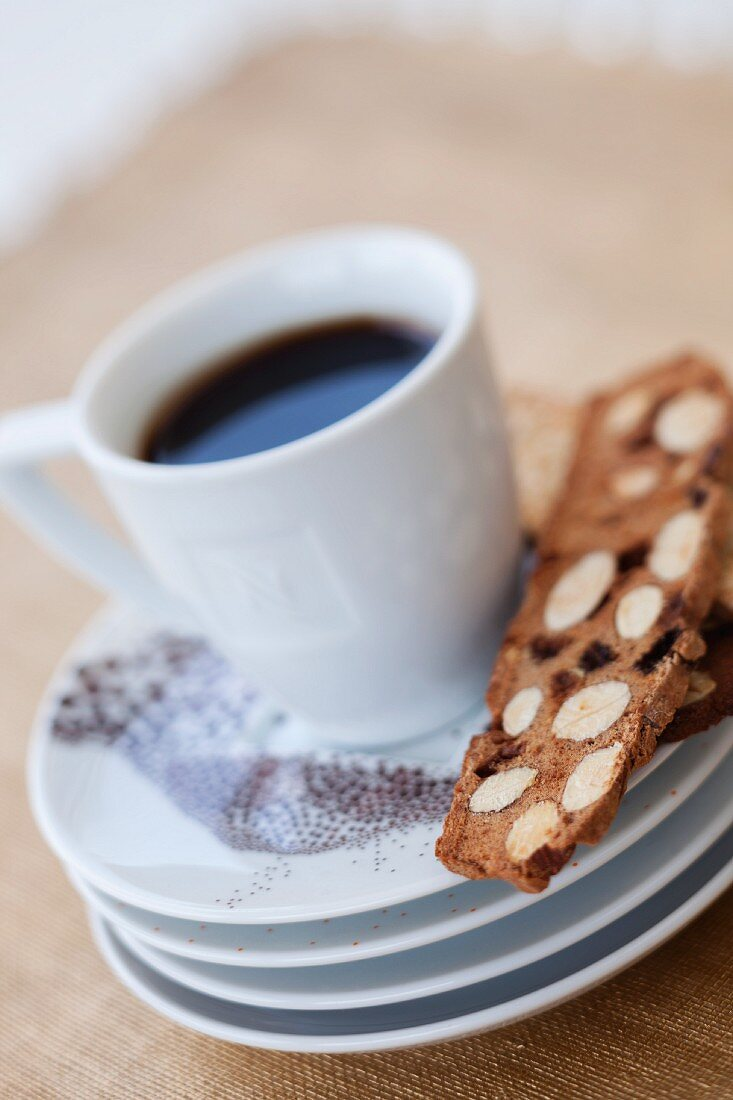 A cup of coffee and almond biscotti