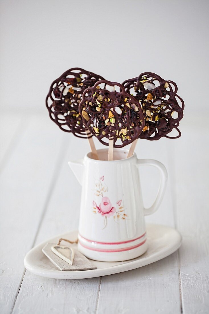 Chocolate lollies with dried fruits