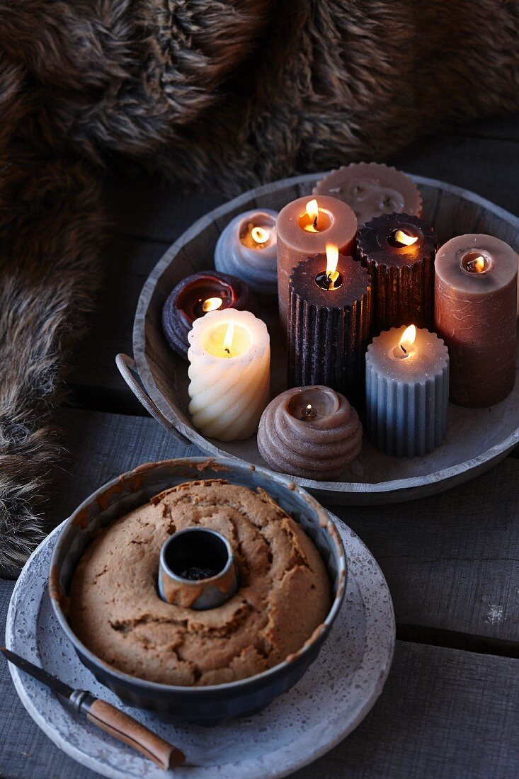 Lit candles in bowl