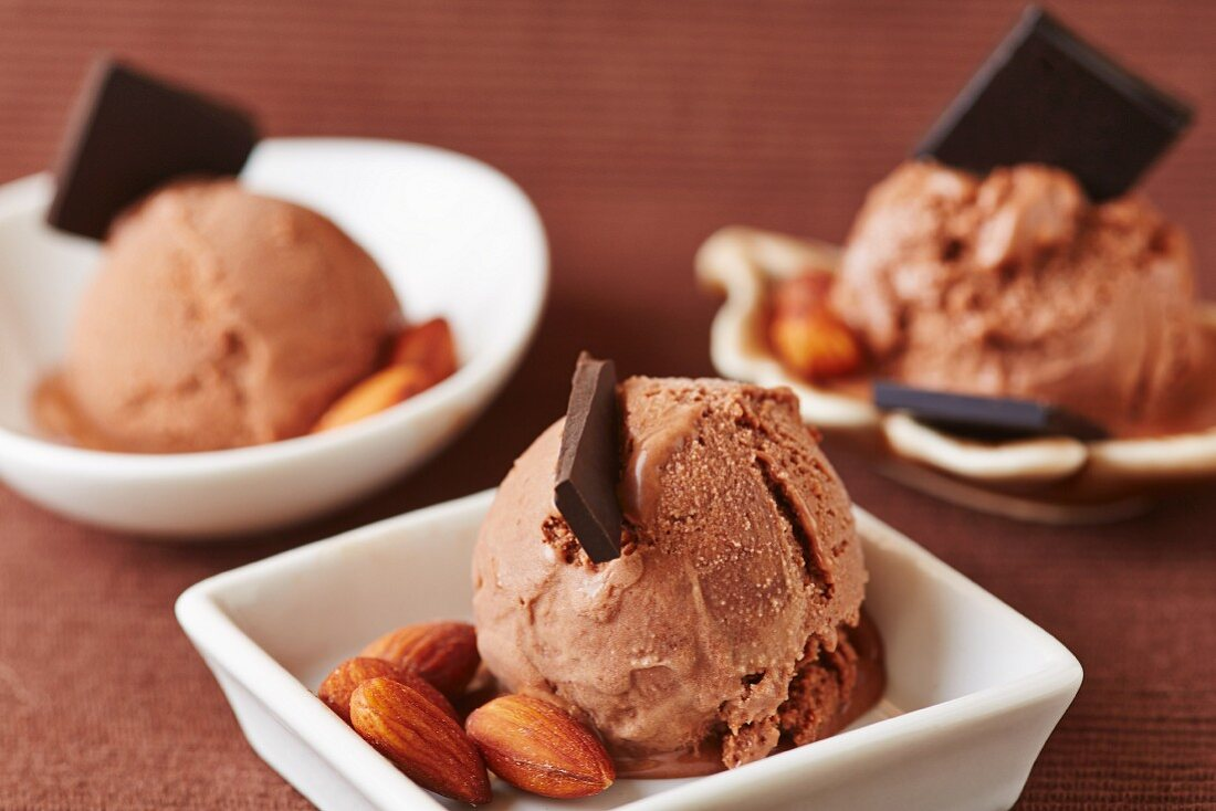 Chocolate ice cream with chocolate curls and almonds