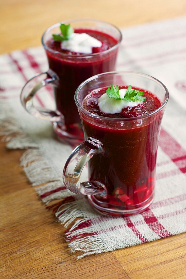 Beetroot and tomato gazpacho garnished with a dollop of soya yoghurt and parsley leaves