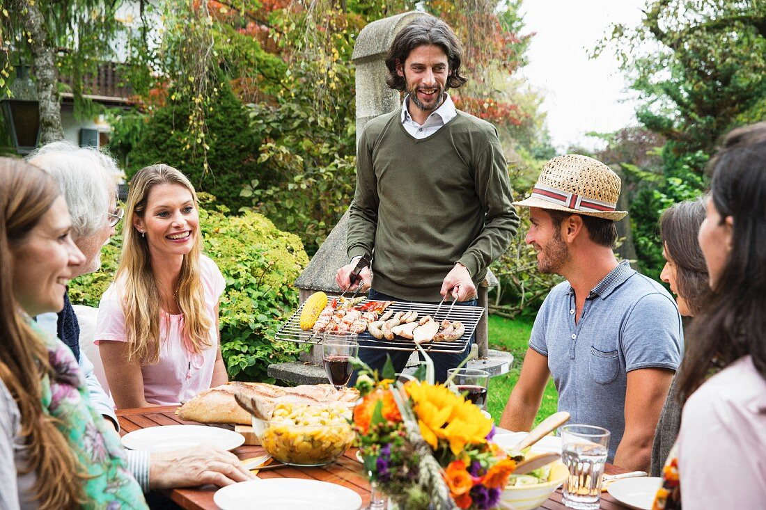 People having a barbecue in a garden