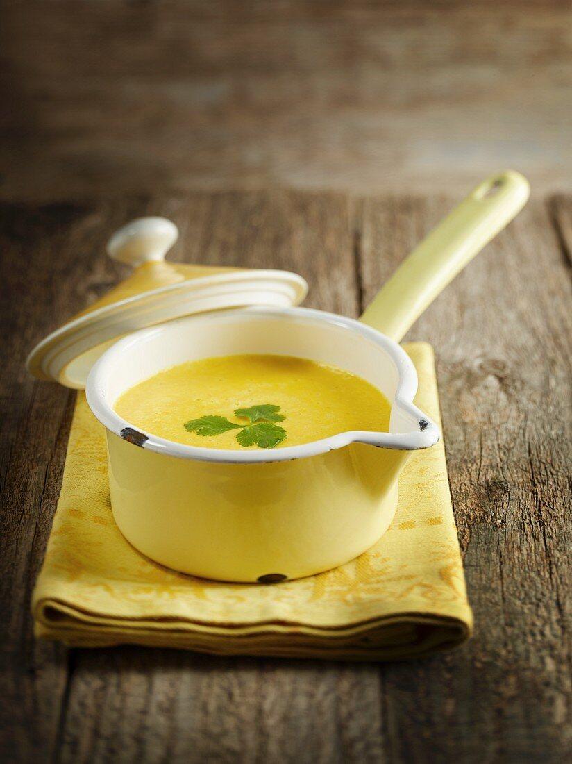 Yellow pepper soup in a saucepan