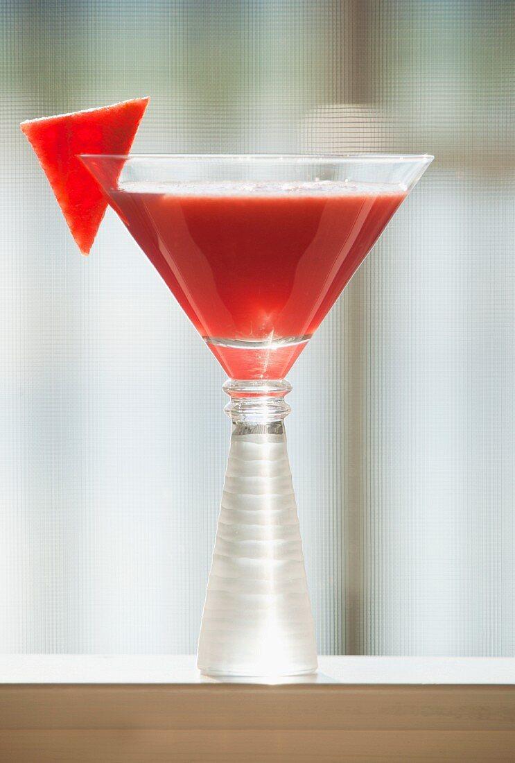 A watermelon Martini with a melon wedge
