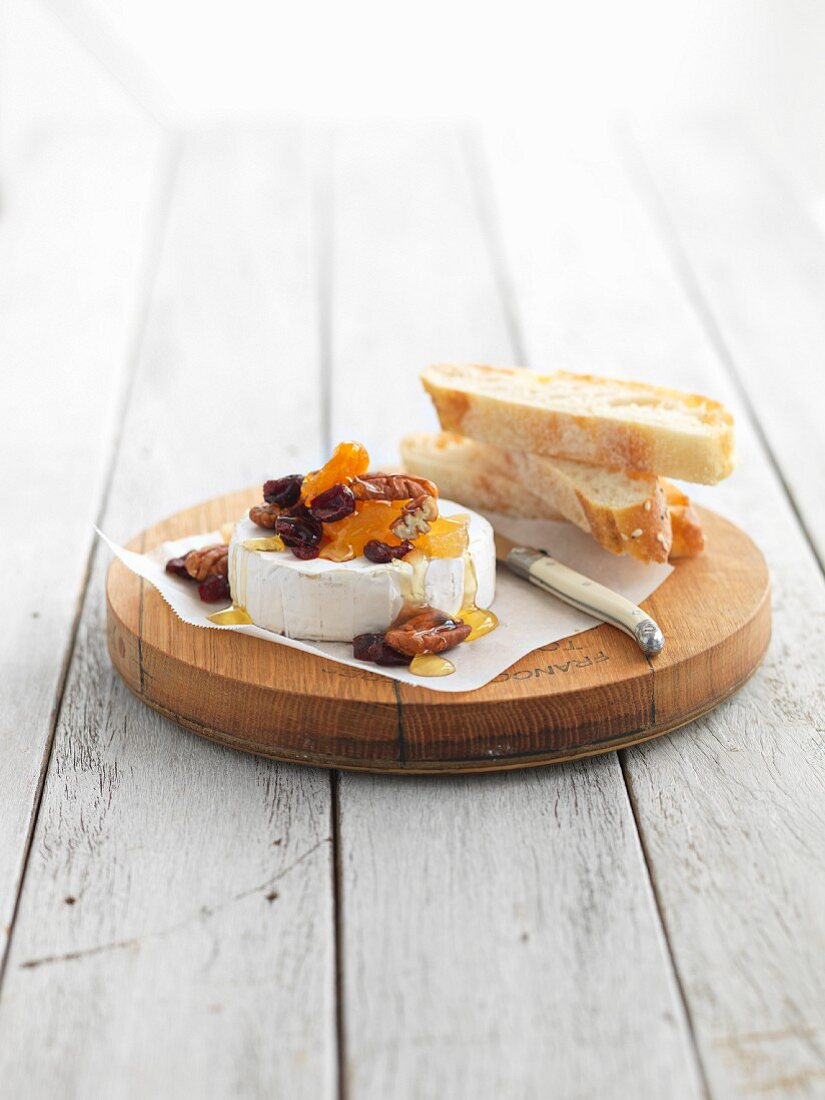Camembert with dried fruits, nuts and honey