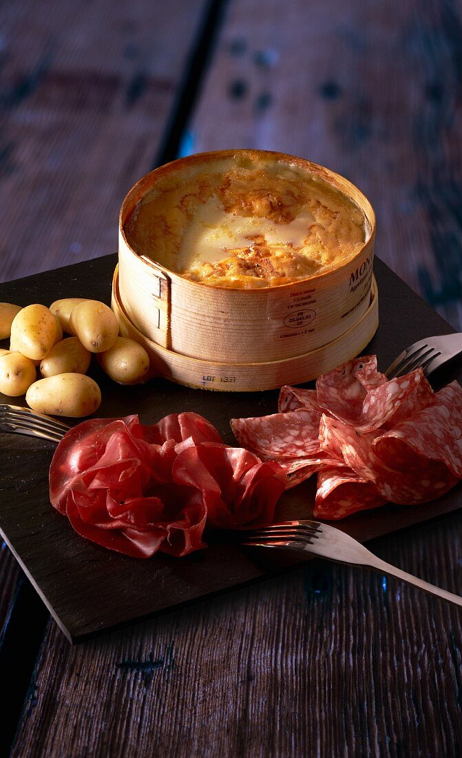 Cheese fondue with sausage and potatoes