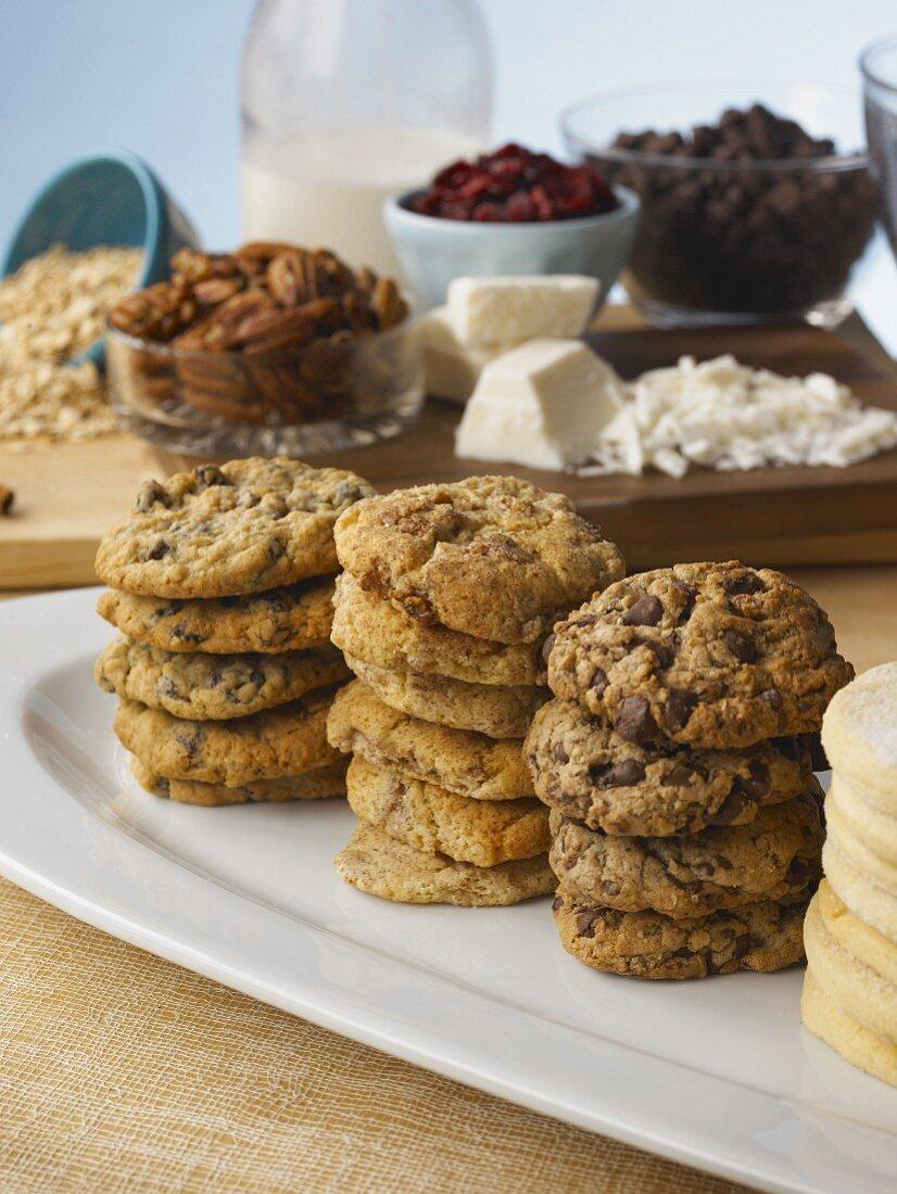 Various stacks of cookies with ingredients