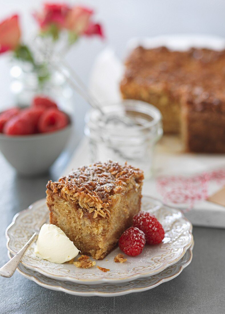 Apple cake with cream and fresh raspberries