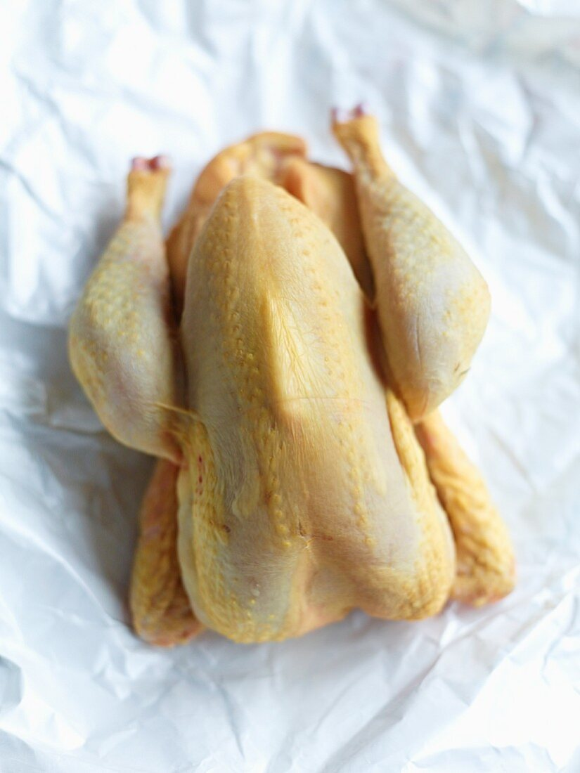 Corn-fed chicken on a piece of paper