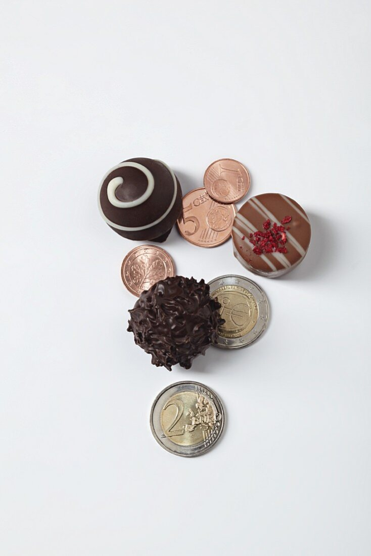 A symbolic image of a gourmet investment: pralines and money