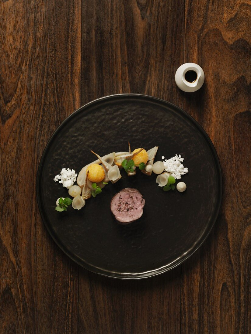 Dry-aged veal with onions, artichokes, mahon cheese and vinegar jus