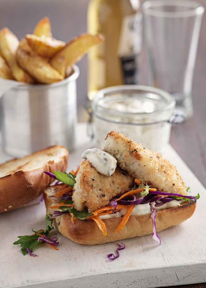 Fish burgers with sauce tartare and potato wedges