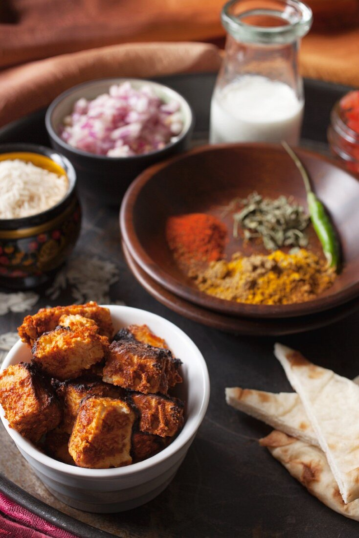 Grilled paneer, ingredients and spices for paneer tikka masala (India)