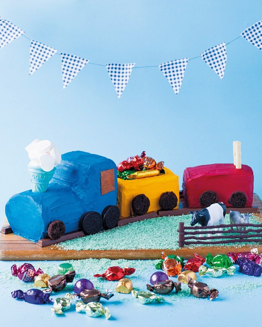 A colourful train cake filled with sweets for a children's birthday party