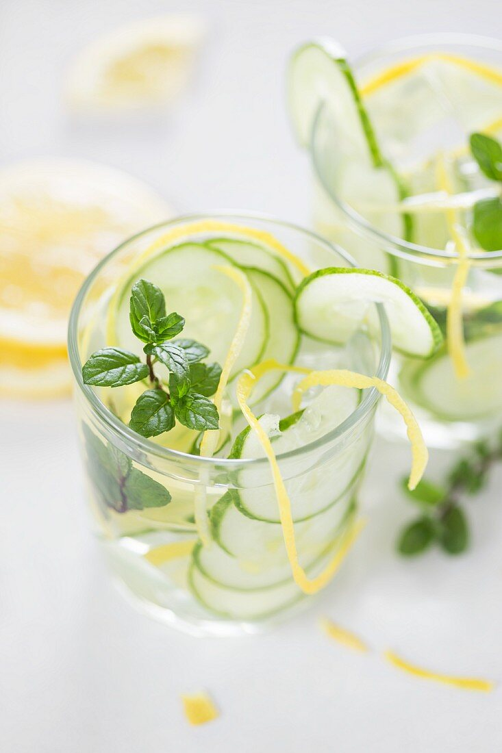 Water flavoured with cucumber, lemon and mint
