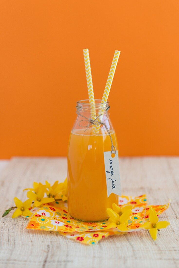 Freshly pressed orange juice in a glass bottle