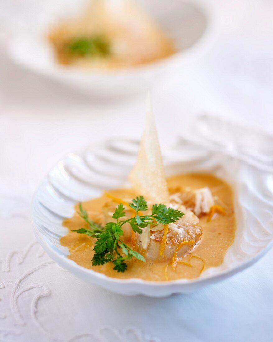 Scallops in orange sauce