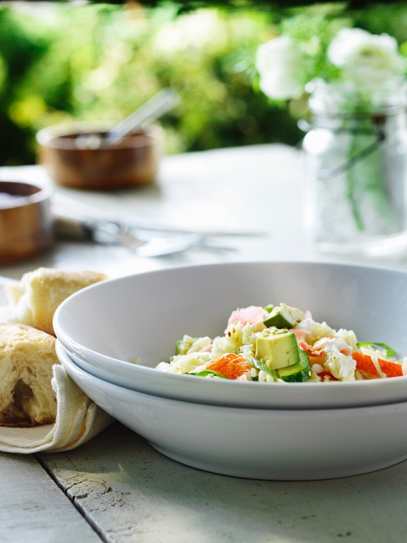 Noodle rice salad with crab, avocado, cucumber and spring onions