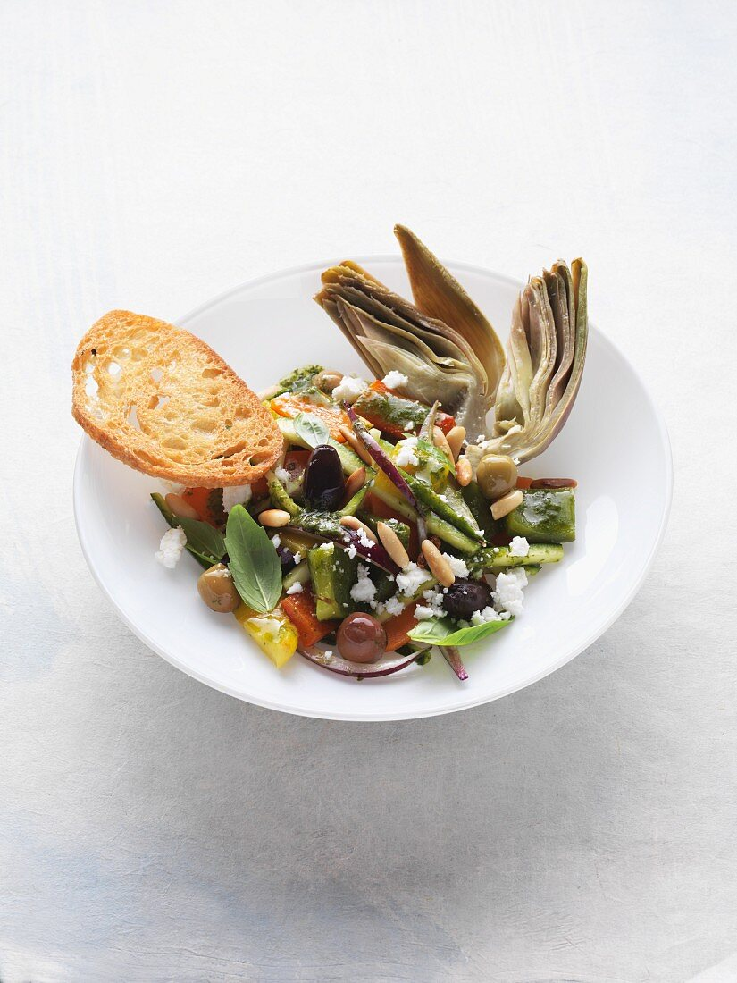 Neapolitan vegetable salad with pine nuts, sheep's cheese and olives