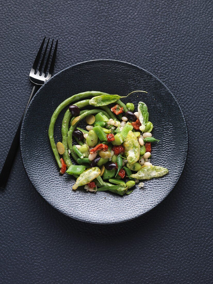 Mixed bean salad with black olives and fried sage