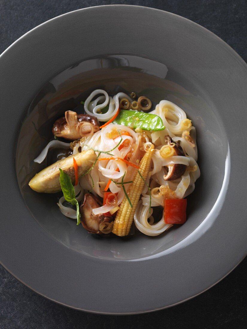 Vegan rice noodles with fried, oriental vegetables