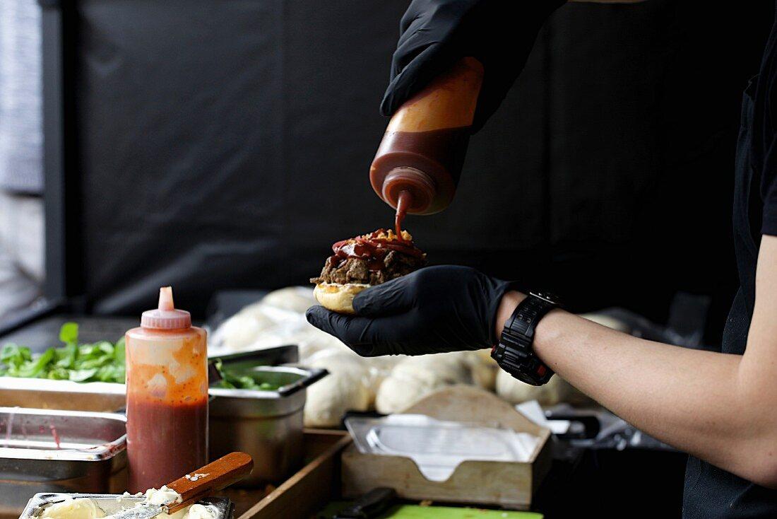 A burger being made