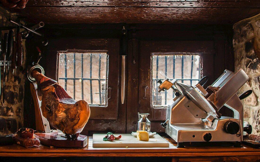 Serrano ham and an electric cutting machine
