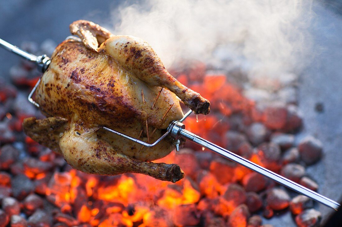 Grilled chicken with an almond and mushroom stuffing on a spit