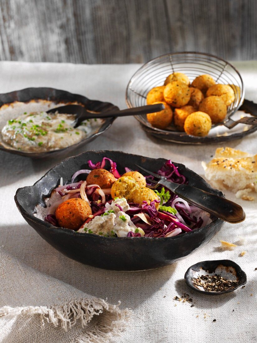 Falafel with a sesame yoghurt dip and a red cabbage and radish salad