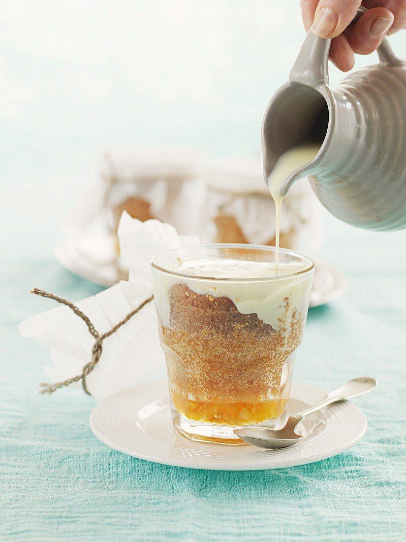 A mini sponge cake with marmalade and cream