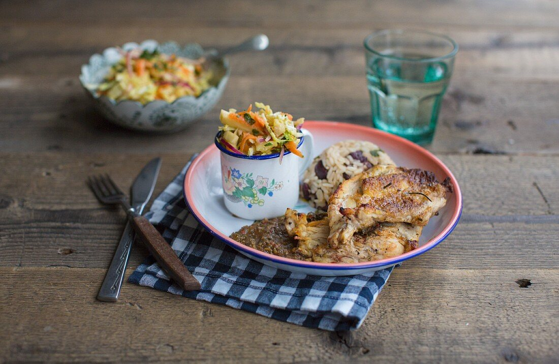 Jerk chicken with rice, peas, pineapple and coleslaw
