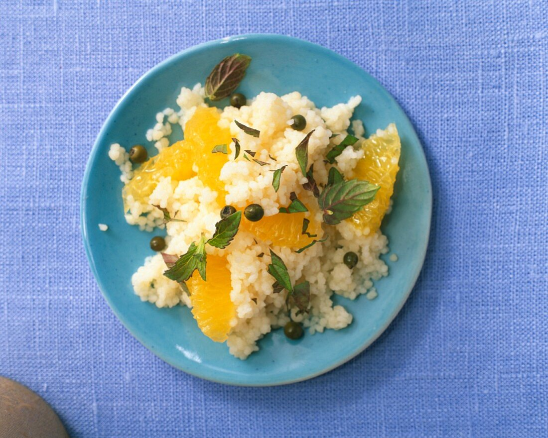 Couscous with pineapple sage, oranges and green pepper