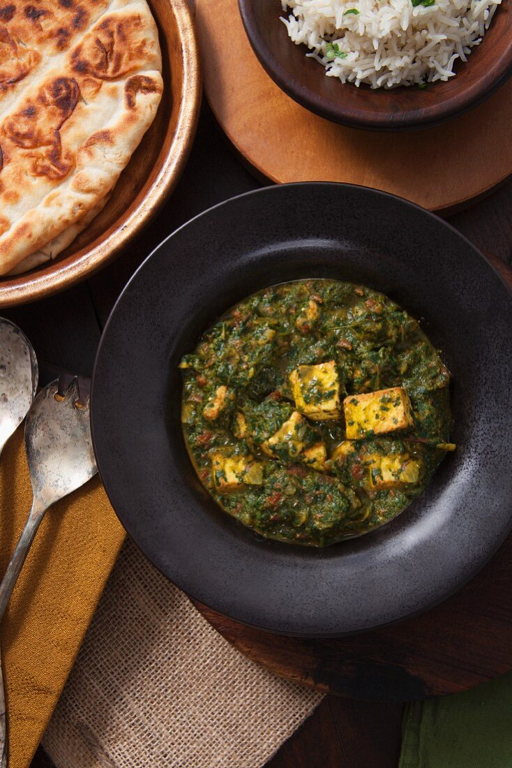 Saag Paneer (cheese dish with spinach, India) with rice and naan bread