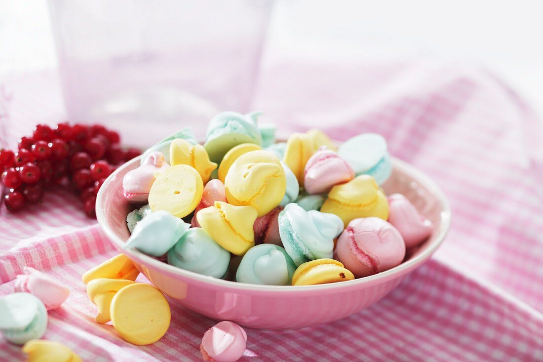 Colourful meringue dots in a pink bowl