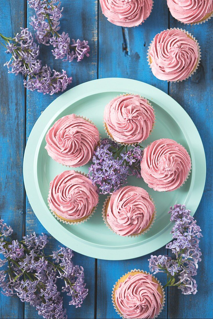 Cupcakes with raspberry frosting on a plate