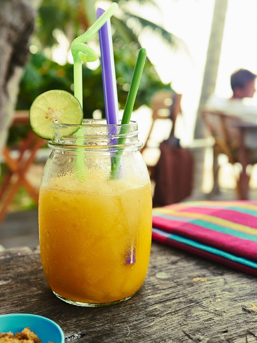 An iced orange drink with ginger and apple