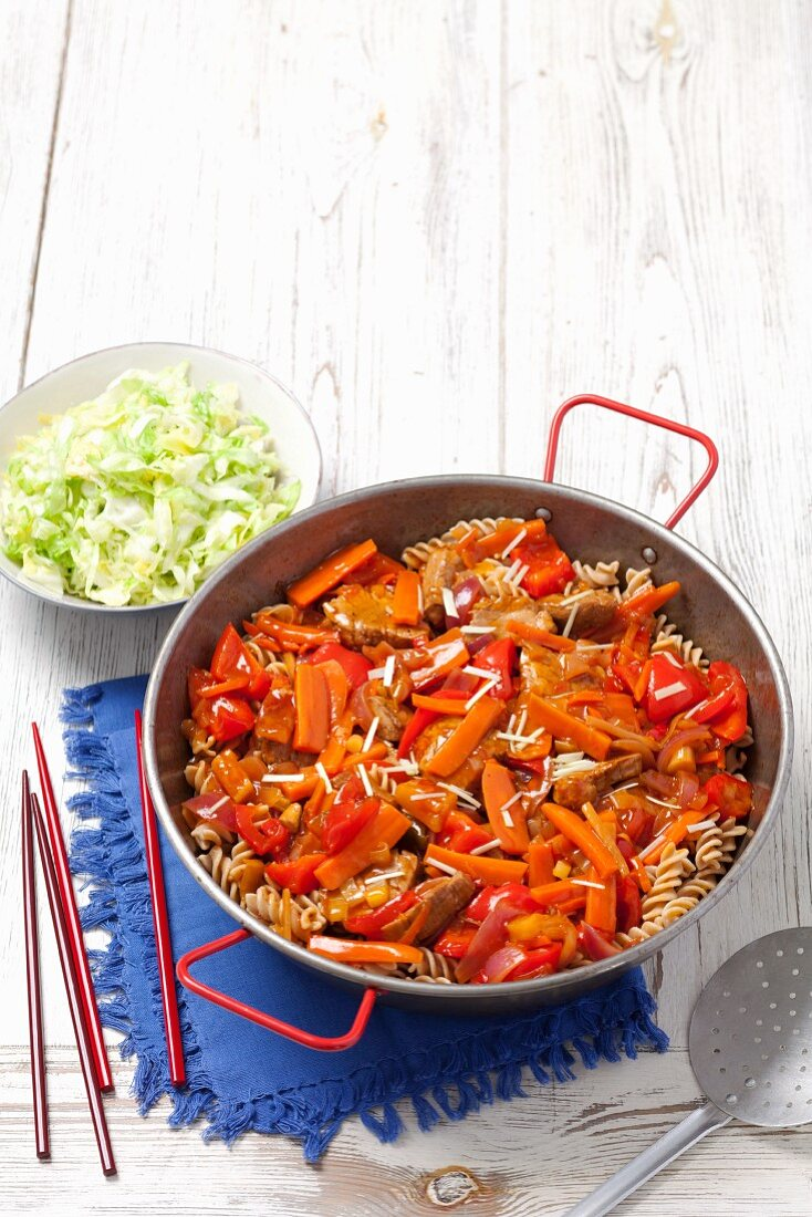 Sweet-and-sour pork loin with wholemeal pasta (Asia)