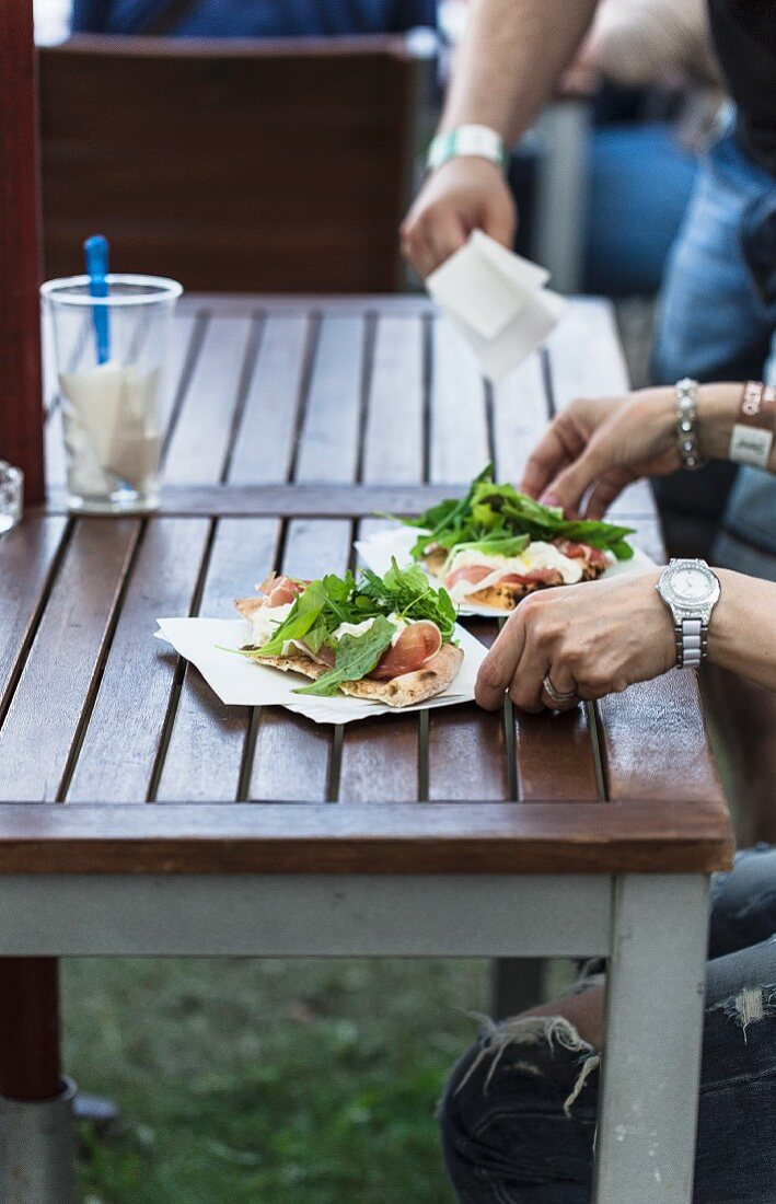 Unleavened bread with raw ham and rocket at a fast food stand
