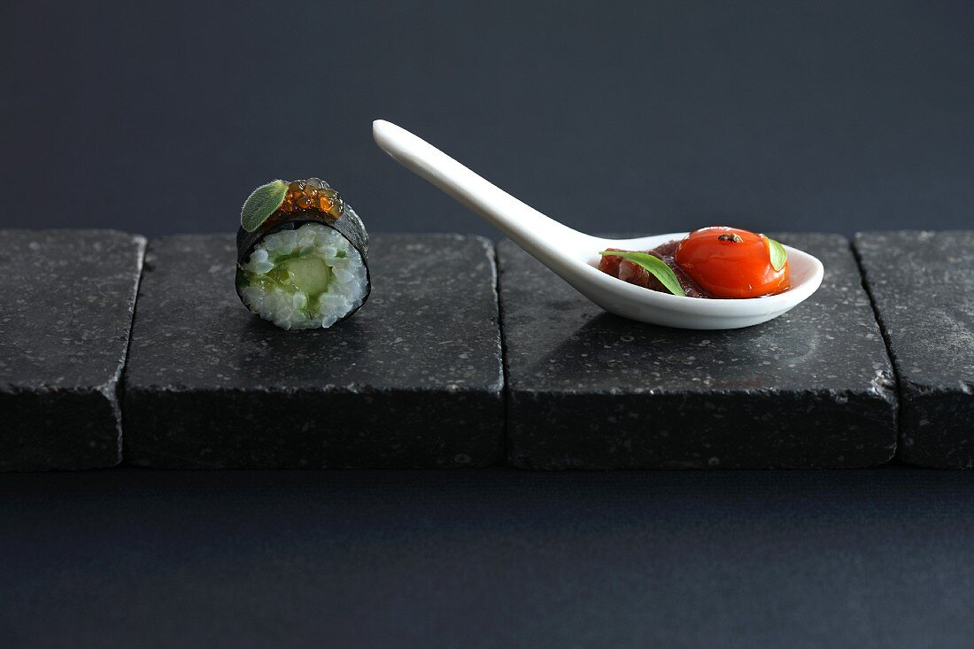 East meets West: maki sushi and tomatoes with basil
