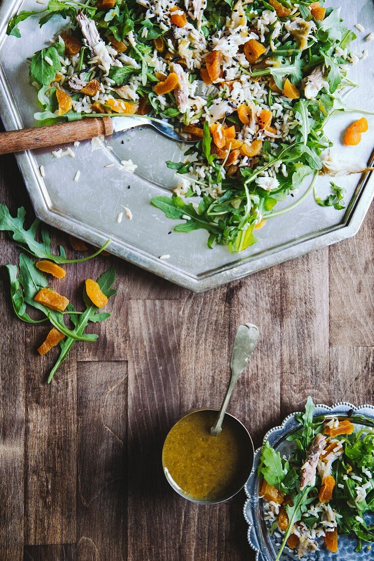 Rice salad with mackerel, rocket and dried apricots