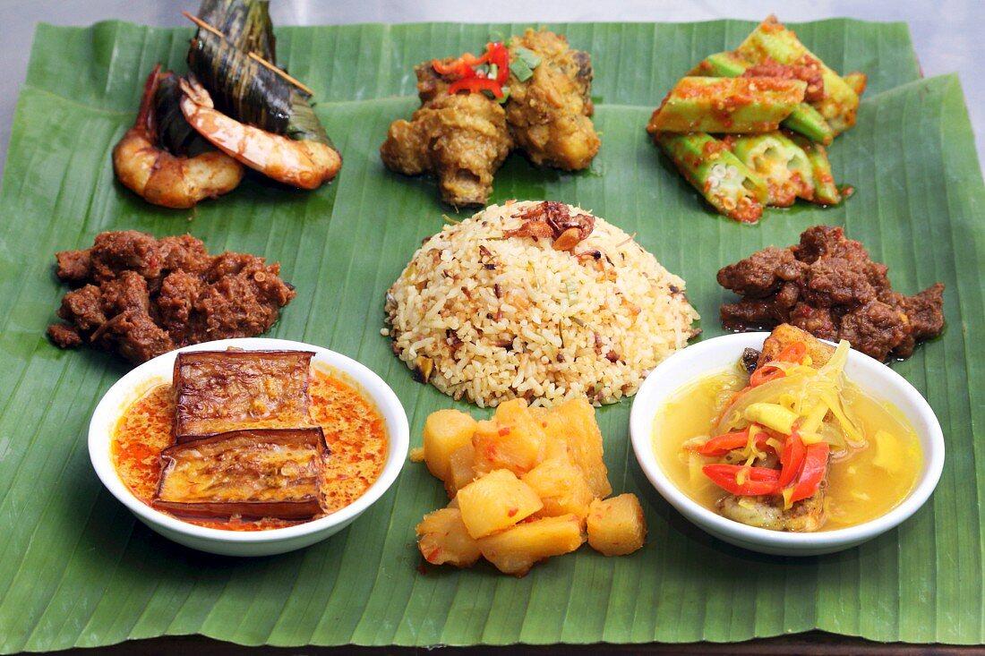 Various Nyonya dishes on banana leaves (Malaysia)
