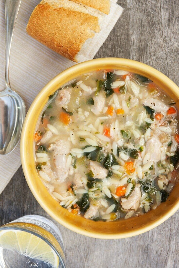 Chicken and lemon soup with spinach and orzo pasta