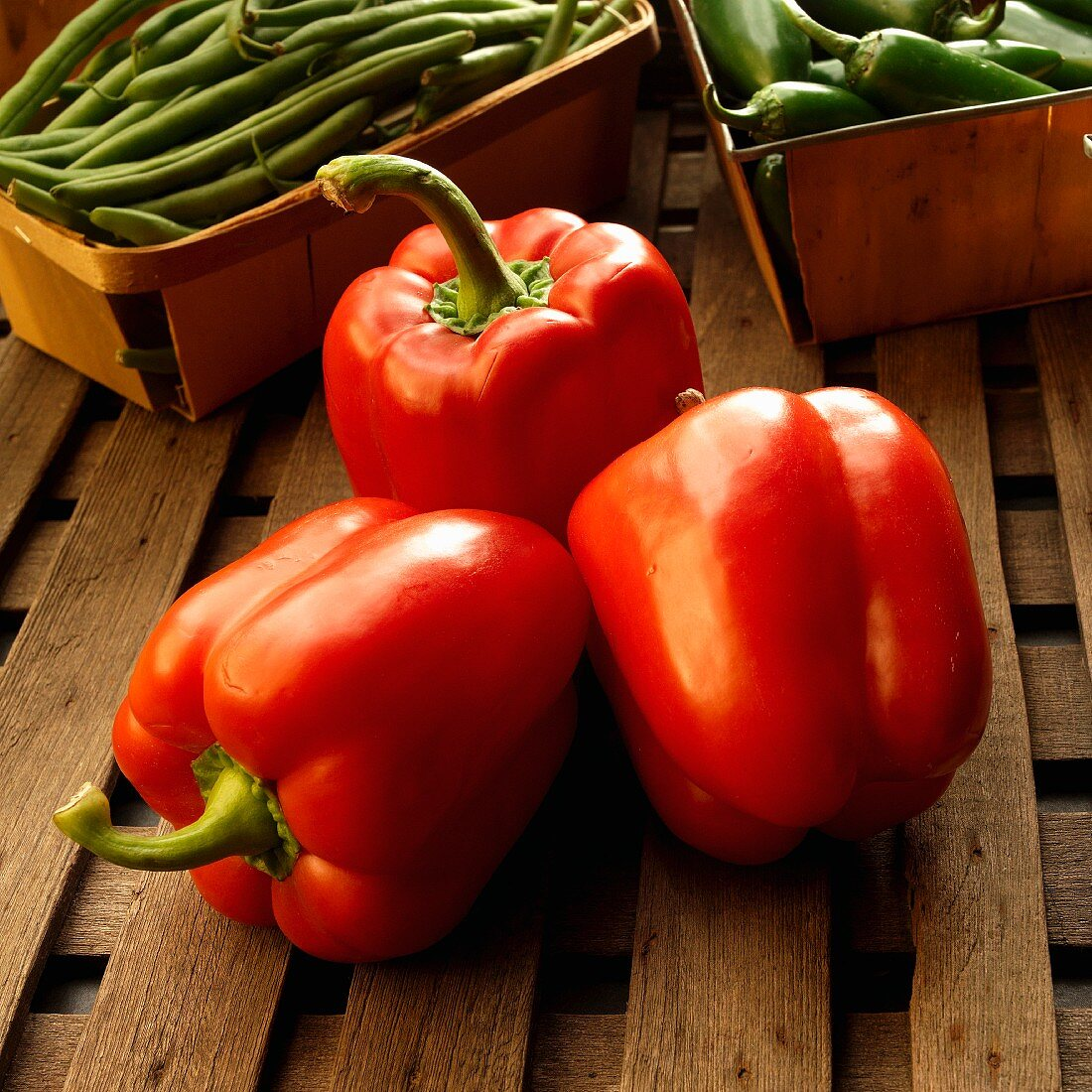 Organic red peppers, string beans and chilli peppers at a farmers market